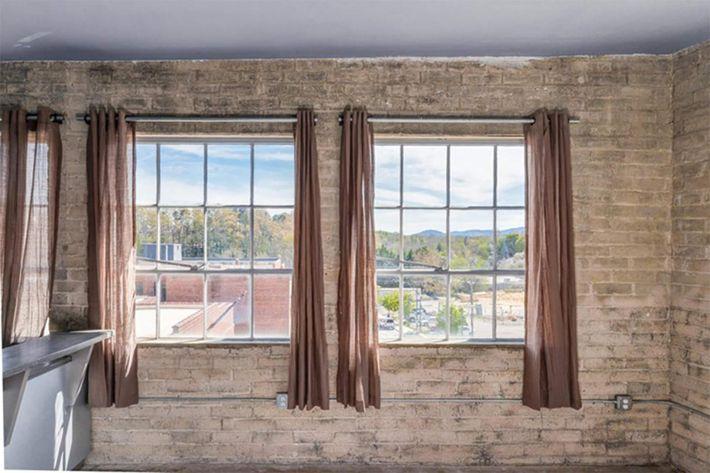 Beautiful exposed brick walls at The Lofts at South Slope in Asheville, NC.