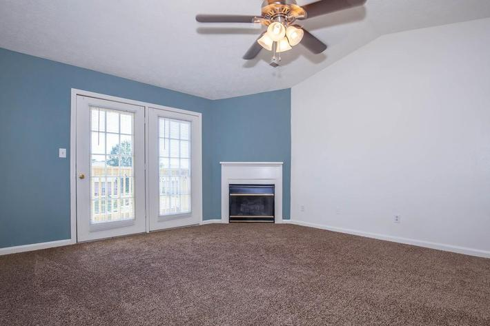 Living Room with Gas Log Fireplace and Balcony or Patio Access