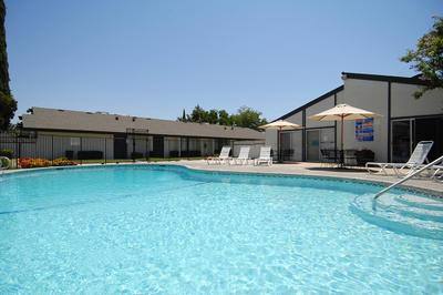 Take a dip in the pool at Westwood Apartments