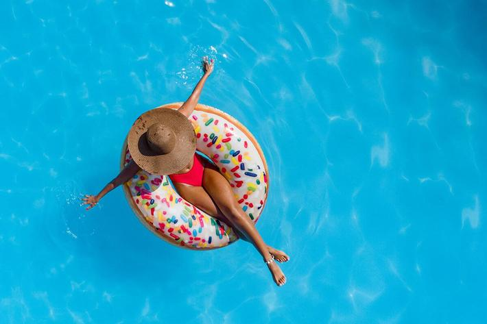 Woman-Donut-Floaty-Pool-GettyImages-1061372788.jpg