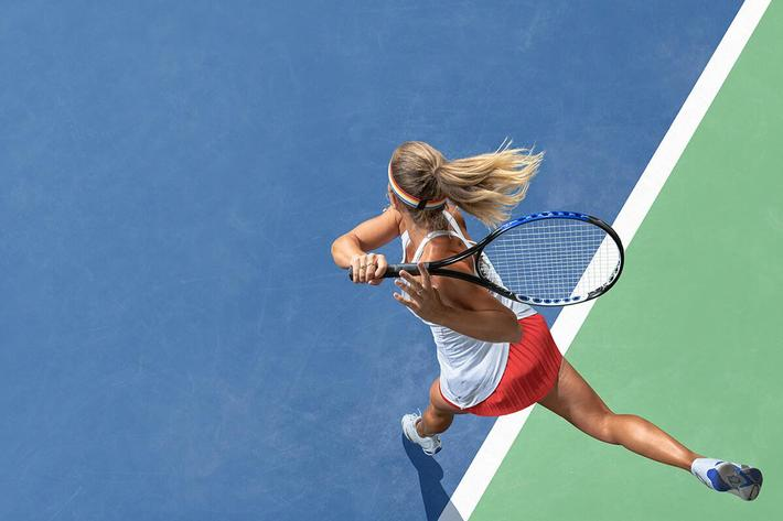 woman playing tennis - GettyImages-1026766054.jpg