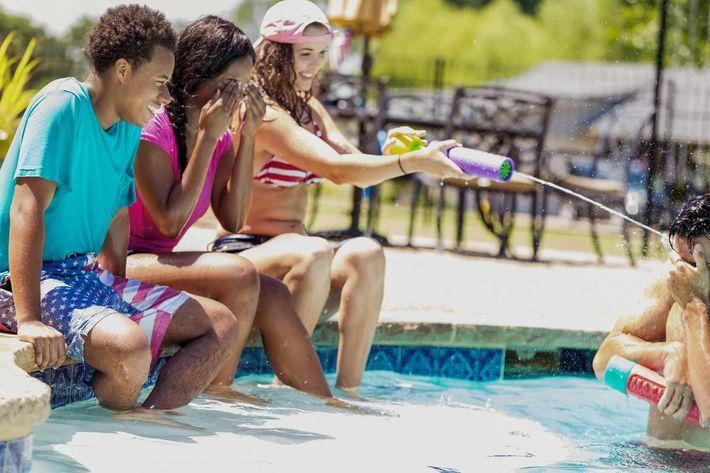 Friends at pool-iStock-582316594.jpg