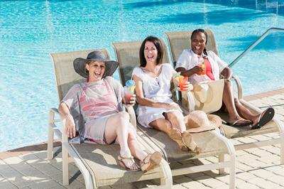 Women having drinks by pool.jpg