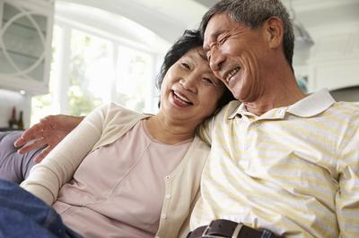 Senior Asian Couple on couch.jpg