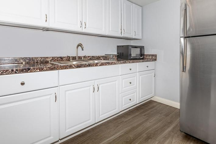 Clubhouse with a well-equipped kitchen at Laurel Park Apartments