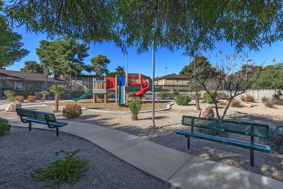 ALPINE VILLAGE OFFERS BENCH SEATING ALONG SIDE THE CHILDRENS PLAY AREA