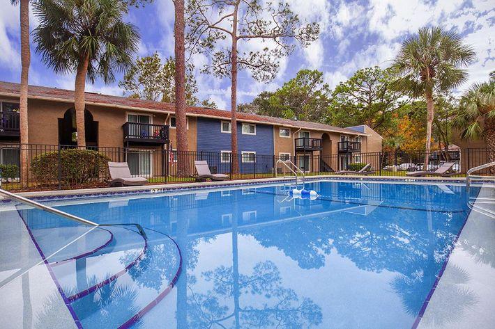 Enjoy the shimmering swimming pool here at Heron Walk Apartments in Jacksonville, Florida