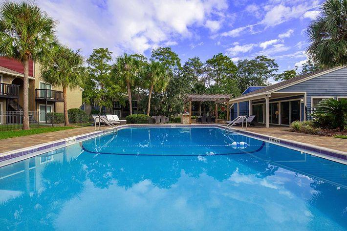 Swim some laps here at Heron Walk Apartments in Jacksonville, Florida