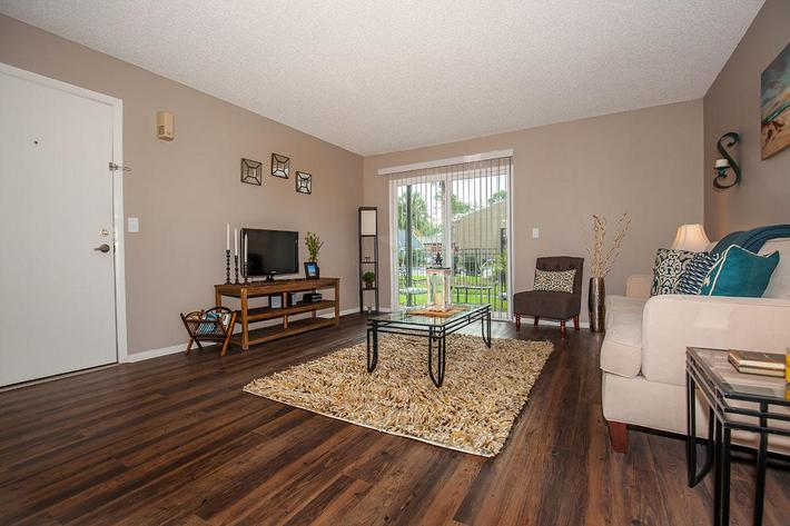 The Muscovy living room at Heron Walk Apartments in Jacksonville, Florida