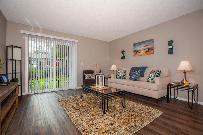 The Muscovy open living room at Heron Walk Apartments in Jacksonville, Florida