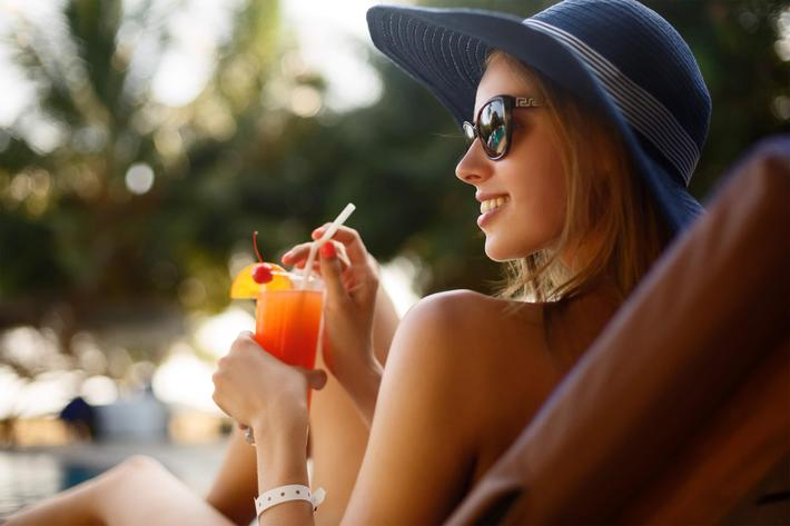woman at pool with drink - iStock-810169000.jpg
