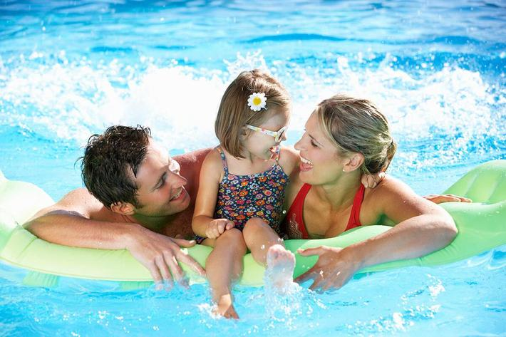 family having fun in the swimming pool iStock-171578745.jpg