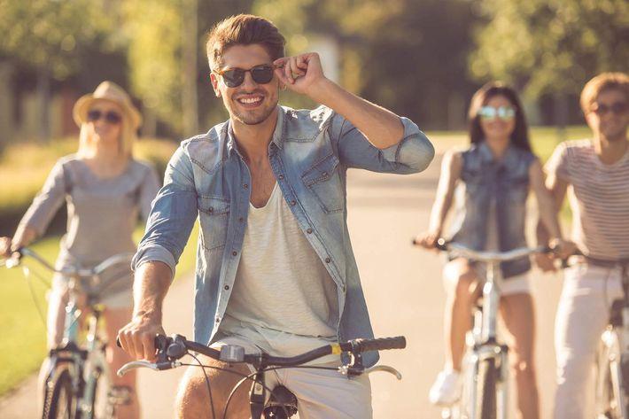 Friends cycling in park iStock-618221008.jpg