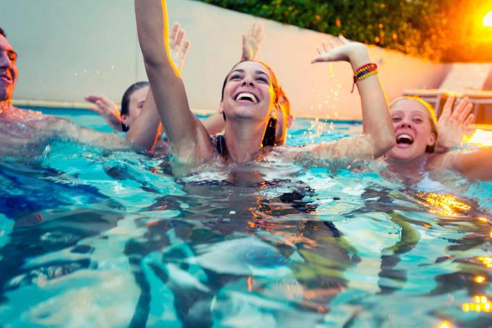 Group of happy young people partying in a pool iStock_59773924_LARGE.jpg