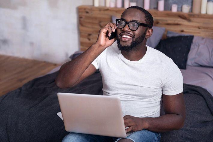 African man talking on a cellphone.jpg