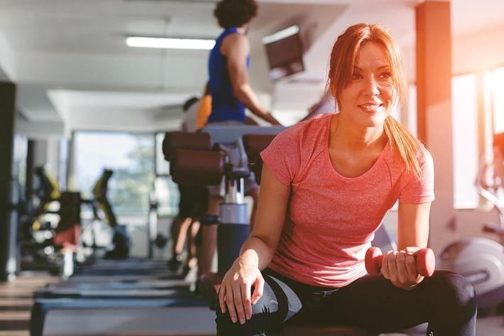 amenities-fitness-woman-free-weights.jpg