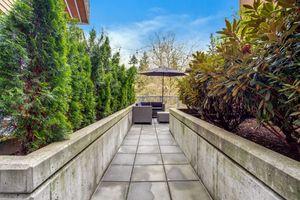 a stone bench in a garden