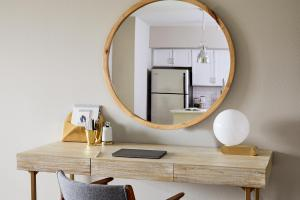 a room filled with furniture and a mirror