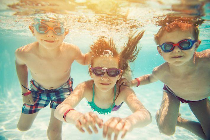 Children Having Fun in Swimming Pool