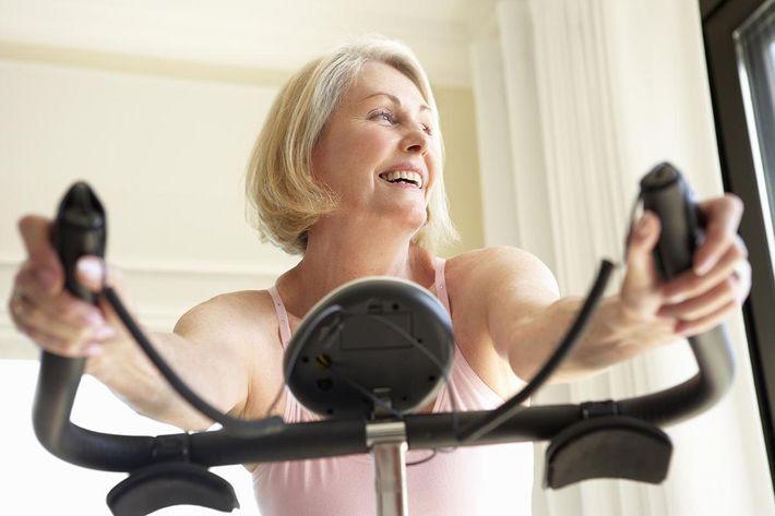 Senior Woman On Exercise Bike.jpg