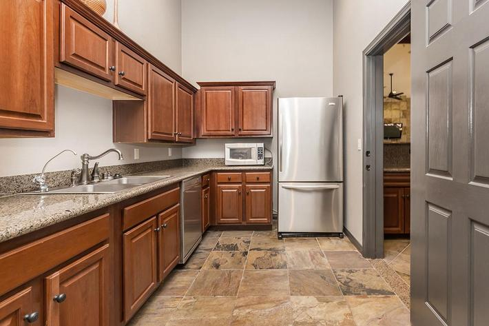 Community kitchen area at The Palladium Apartments in Las Vegas, Nevada