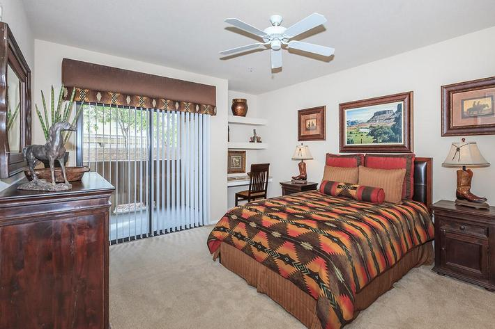 Comfortable bedroom at The Palladium Apartments in Las Vegas, Nevada