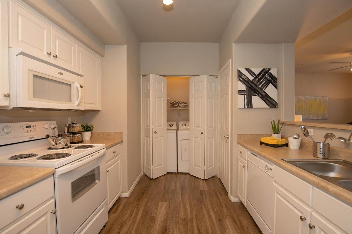 GOURMET KITCHEN WITH LAUNDRY ROOM