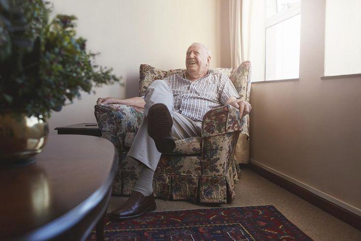 Elderly man sitting on arm chair.jpg