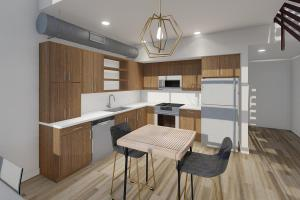 a kitchen with wooden cabinets and a table in a room