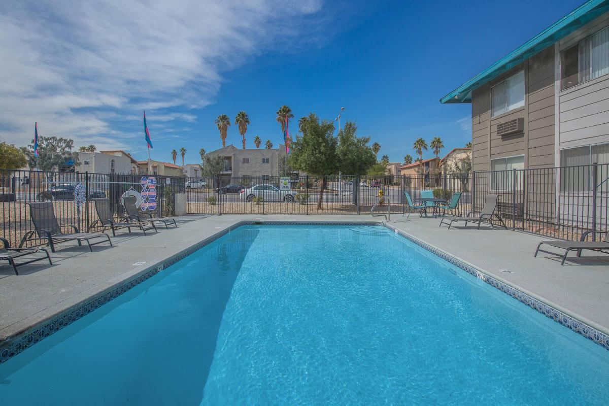 Take a dip in the shimmering pool at Woodhaven Apartments in Las Vegas, Nevada