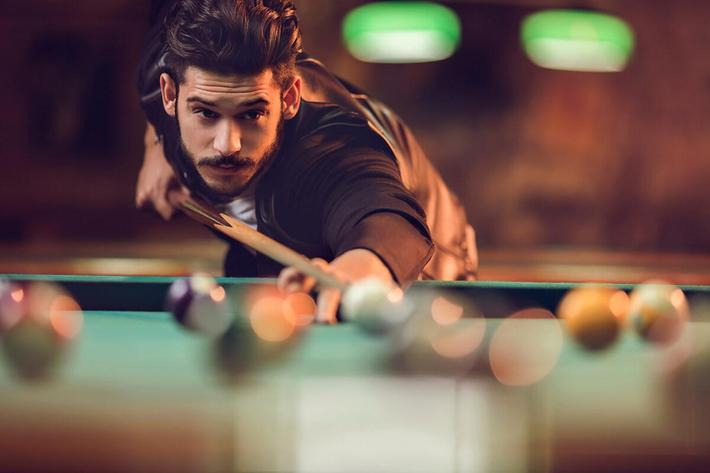 Copy of Young man playing billiard in a pool hall iStock_78986005_LARGE.jpg