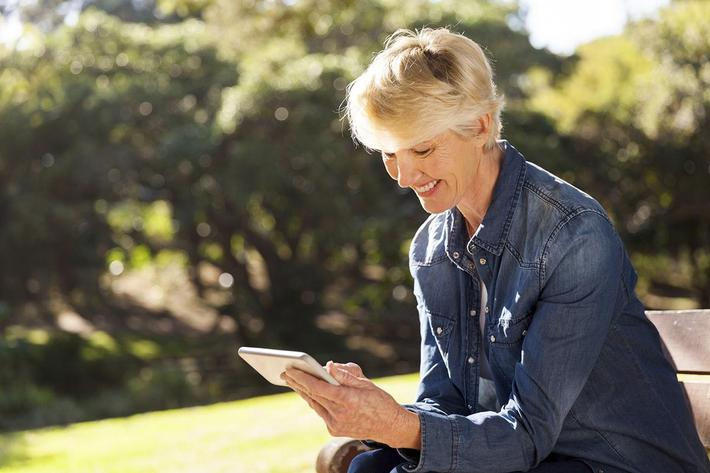 senior blond woman texting.jpg