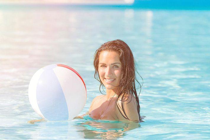 amenities-pool-woman-beach-ball.jpg