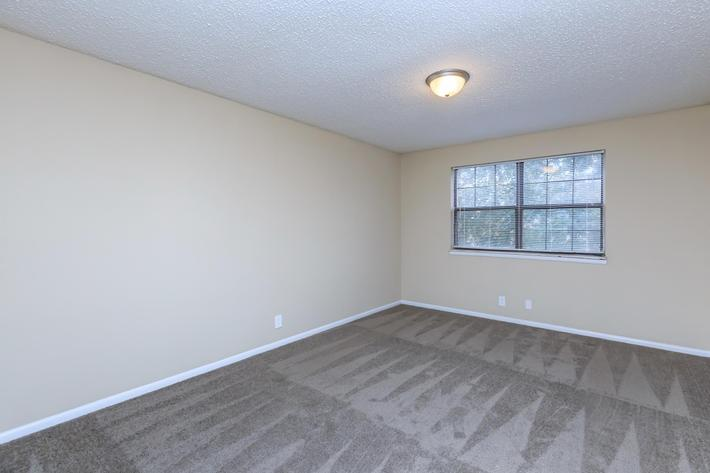 Plush carpeted bedroom at Eagles Crest at Jack Miller in Clarksville, Tennessee