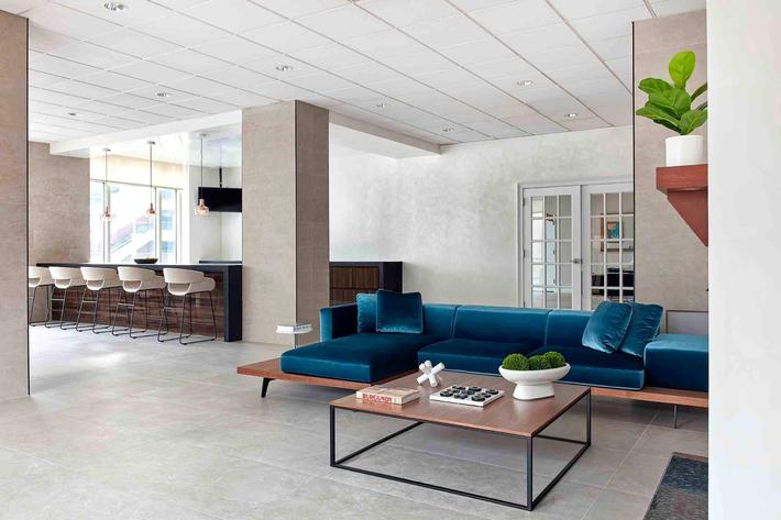 a room filled with furniture and a blue chair