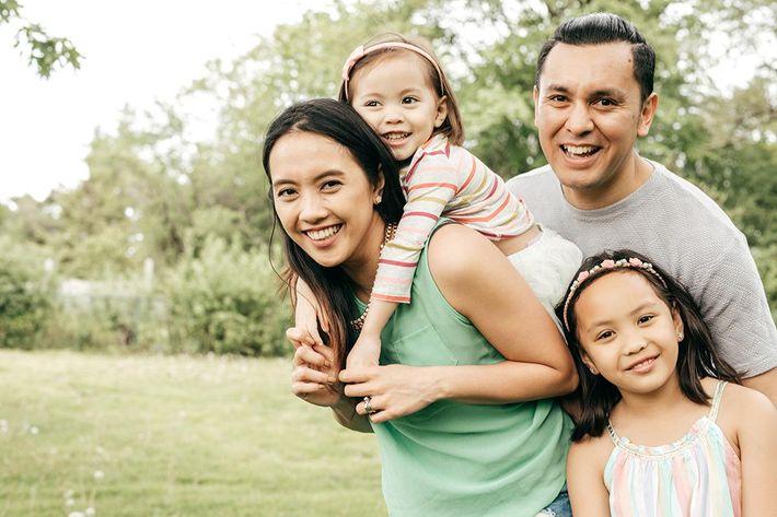 Happy family having fun outdoor iStock-693915920.jpg