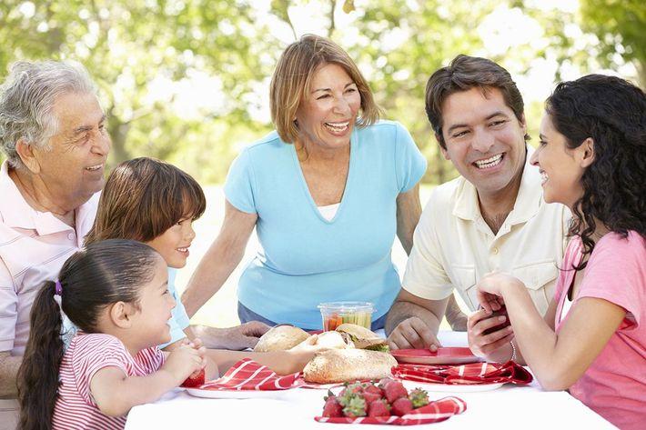Hispanic family enjoying picnic outside iStock-155132132.jpg