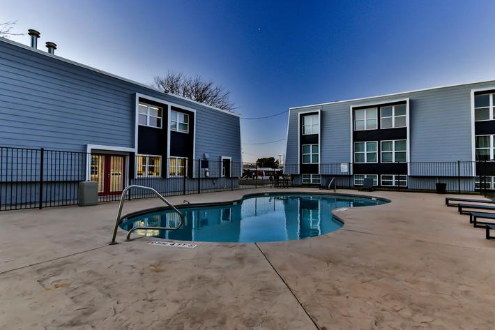 Relax and lounge around The Pointe Apartments swimming pool