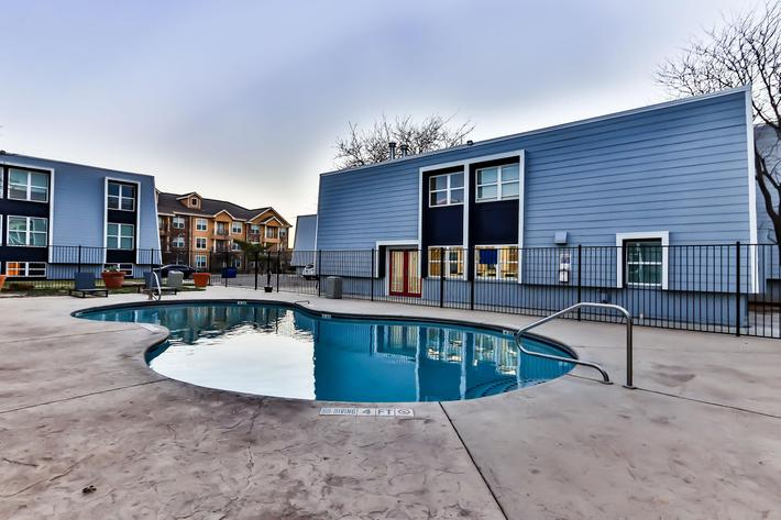 Sparkling swimming pool at The Pointe Apartments