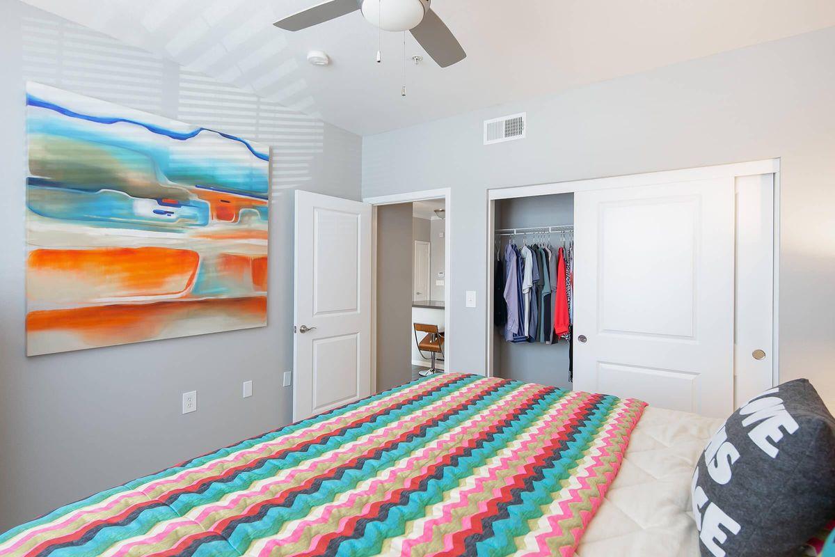 Bedroom with open sliding closet doors