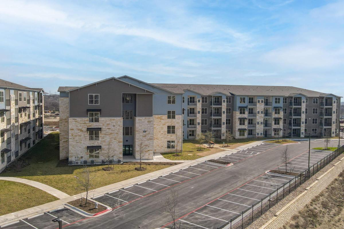 Pflugerville Senior Living - Legacy Ranch at Dessau East Front Sign with a Prime Fremont Location Near the Best Dining and Shopping Experiences with a Sparkling Pool, Assigned Parking, and Much More