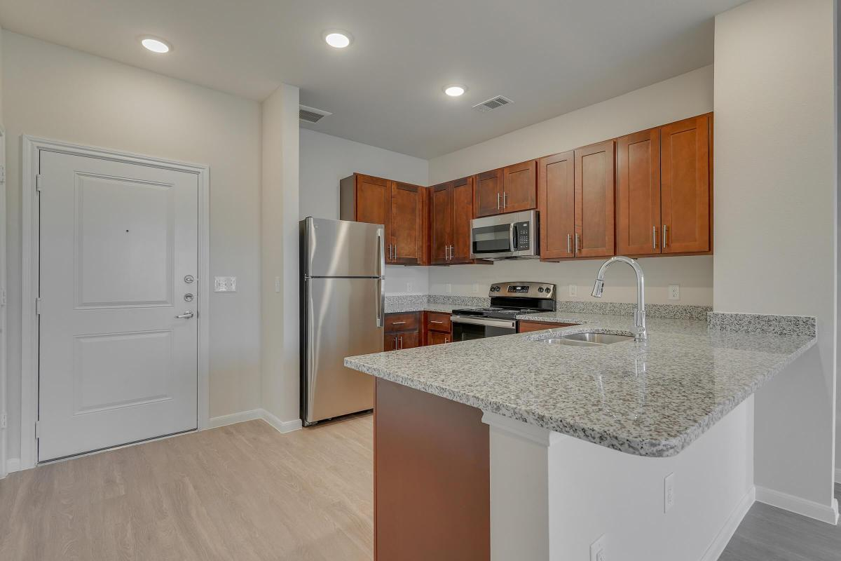 Pflugerville TX Senior Living- Legacy Ranch at Dessau East Spacious Kitchen with Plenty of Counterspace, Wooden Cabinetry, Energy Efficient Appliances, and Much More