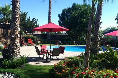 Relax beside the pool at Providence Pointe