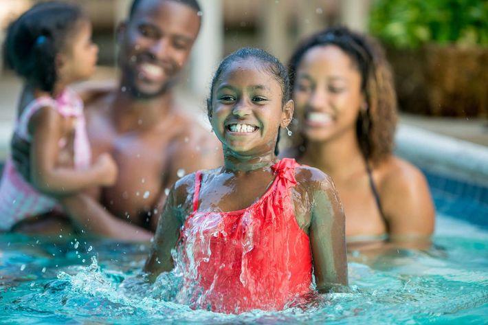 Family in pool-iStock-463243439.jpg