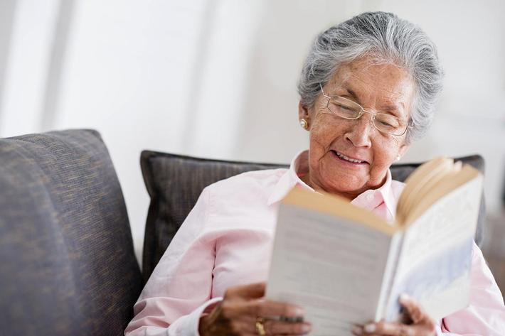 Elder woman reading a book.jpg