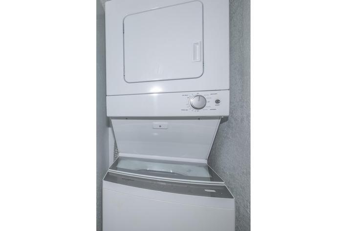 a white refrigerator freezer sitting inside of it