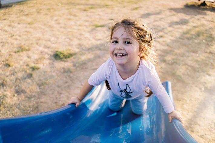 girl on slide GettyImages-1061471346.jpg