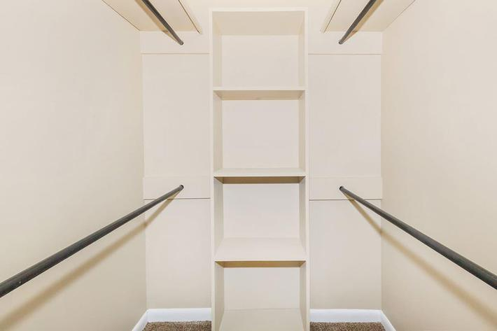 THE SPACIOUS WALK-IN CLOSET OF A 1-BEDROOM 1-BATHROOM APARTMENT AT VAN MARK APARTMENTS IN MONROE, LA