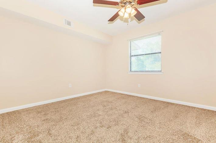 NEW BEIGE CARPETING-FRESHLY PAINTED WALLS IN A 2-BED 2-BATH APARTMENT BEDROOM AT VAN MARK APARTMENTS IN MONROE, LA
