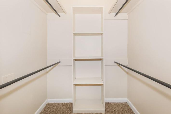 THE SPACIOUS WALK-IN CLOSET OF A 2-BEDROOM 2-BATHROOM APARTMENT AT VAN MARK APARTMENTS IN MONROE, LA
